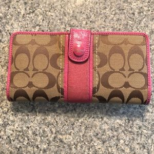 Large used pink and tan Coach wallet